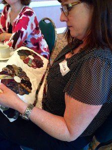 Motherless Daughters Memory Bash Woman Sitting Holding Quilt
